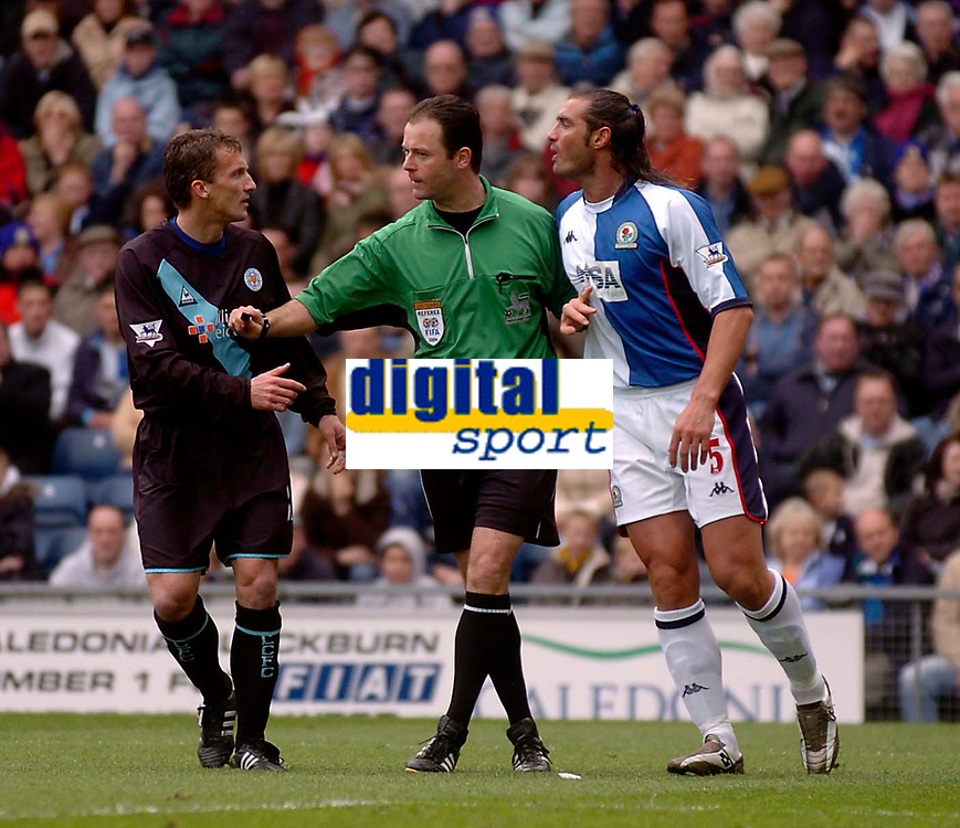 Photo. Glyn Thomas, Digitalsport.<br /> Blackburn Rovers v Leicester City. <br /> FA Barclaycard Premiership. 17/04/2004.<br /> Referee Rob Styles (C) is forced to hold Leicester's Billy McKinlay (L) apart from Lorenzo Amoruso as they have angry words which earnt both a yellow card.
