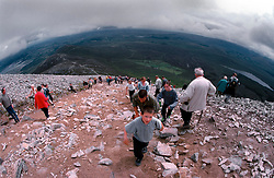 IRELAND CO. MAYO CORAGH PATRICK JUL99 - Pilgrims ascend Croagh Patrick mountain in western Ireland. Around 25,000 people, some of which are bare-footed, participate in this pilgrimage to the top of Croagh Patick mountain on the last Sunday of July from where in 441 A.D. St. Patrick supposedly sent Ireland's reptiles to their doom. ..jre/Photo by Jiri Rezac..© Jiri Rezac 1999..Contact: +44 (0) 7050 110 417.Mobile: +44 (0) 7801 337 683.Office: +44 (0) 20 8968 9635..Email: jiri@jirirezac.com.Web: www.jirirezac.com..© All images Jiri Rezac 1999 - All rights reserved.