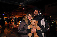 Cathy Rider of Eaton and Dan DeLong, Jr. of Englewood stop with the bear that Dan used as a sign to the carriage drivers that he was going to propose to her on their ride during Horse-Drawn Carriage Rides & Star Late Skate night at RiverScape MetroPark in downtown Dayton, Saturday, December 18, 2010. They said they met two years ago via e-Harmony, and DeLong said the proposal tonight was because he wanted to do something special.