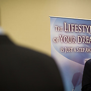 "A coaching service displays a ""The Lifestyle of Your Dreams"" sign at a job fair at the Rosslyn Holiday Inn in Arlington, VA on Friday, Jan. 15, 2010."