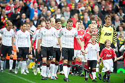 MANCHESTER, ENGLAND - Sunday, September 19, 2010: Liverpool's captain Steven Gerrard MBE leads his side out for the Premiership match against Manchester United at Old Trafford. (Photo by David Rawcliffe/Propaganda)