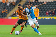 Kevin Stewart of Hull City battles with Bradley Johnson of Blackburn Rovers during the EFL Sky Bet Championship match between Hull City and Blackburn Rovers at the KCOM Stadium, Kingston upon Hull, England on 20 August 2019.