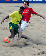 07 December 2006, Brazil's Benjamin da Silva and England's Kieran O'Callaghan fight for the ball during the first game of the Vodacom Pro Beach Soccer Tour starts at Durban's Bay of Plenty on Thursday. Brazil won the game 10 - 3. Picture: Shayne Robinson, PhotoWire Africa