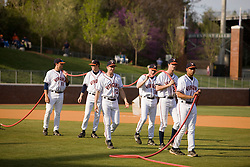 Members of the UVA baseball team assist the grounds crew with pre-game preparations.  The #16 ranked Virginia Cavaliers baseball team defeated the Wake Forest Demon Decons 4-2 at the University of Virginia's Davenport Field in Charlottesville, VA on April 18, 2008.