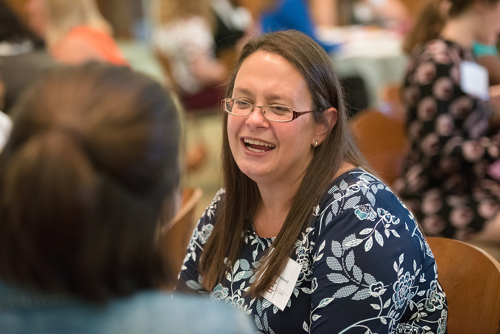 Angela Woodward talks to her mentee during the Women's Mentoring Meet and Greet event on Sept. 4, 2018 in Walter Rotunda. Photo by Hannah Ruhoff