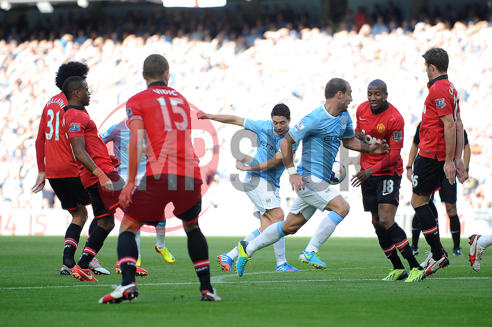 Manchester City's Samir Nasri takes a shot at goal. - Photo mandatory by-line: Dougie Allward/JMP - Tel: Mobile: 07966 386802 22/09/2013 - SPORT - FOOTBALL - City of Manchester Stadium - Manchester - Manchester City V Manchester United - Barclays Premier League