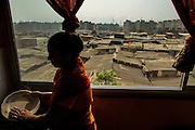 The area is an slum resettlement with 11.000 families, and is wedged between three other slums, housing around one million people. Mangal Podi, 32, has for the last five years had a view over the Sathe Nagar slum.