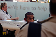 Members of staff at the British Airways information desk in Departures at Heathrow Airport's Terminal 5.