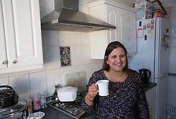 Image ©Licensed to i-Images Picture Agency. 07/03/2015. London, United Kingdom. Ravi Bhanot and family, Conservative Party supporters in Ilford. Ravi, his wife Sushma and their son have a tea with Ravi's sister in Ilford. Picture by Daniel Leal-Olivas / i-Images