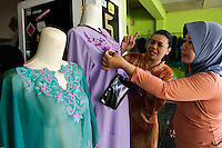 A customer at a women's collective producing traditional clothing, Makassar, Sulawesi, Indonesia.