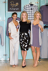 © licensed to London News Pictures. London, UK 16/10/2013. Rosie Huntington-Whiteley (centre) launches her new M&S collection, 'Rosie for Autograph Sleepwear' at M&S store in Marble Arch, London. Photo credit: Tolga Akmen/LNP