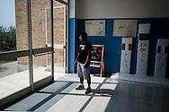 Foggia, Italia - 22 agosto 2013. Un immigrato ritratto all'interno di una struttura di accoglienza a Cerignola.<br /> Ph. Roberto Salomone Ag. Controluce<br /> ITALY - An immigrant is seen inside a welcome accomodation center for immigrants in Cerignola in  the italian southern region of Puglia on August 22, 2013.