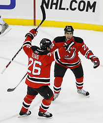 Mar 17, 2009; Newark, NJ, USA; New Jersey Devils left wing Patrik Elias (26) and New Jersey Devils defenseman Mike Mottau (27) celebrate a goal by New Jersey Devils right wing Brian Gionta (14) during the second period at the Prudential Center. Elias had an assist on the play and became the NJ Devils all-time leading scorer with 702 points.