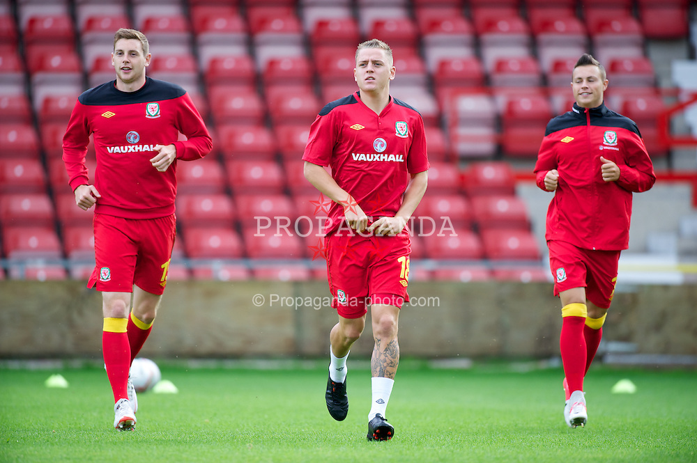 WREXHAM, WALES - Wednesday, August 15, 2012: Wales' Ashton Taylor, Eliott Richards and Billy Bodin warm-up before the UEFA Under-21 Championship Qualifying Round Group 3 match against Armenia at the Racecourse Ground. (Pic by Dave Richards/Propaganda)