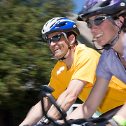 Two happy cyclists, a man and a woman, cross the finish line at U Maine Farmington on the second day of the Trek. The 2007 Trek Across Maine, an annual project of the American Lung Association of Maine (ALAM).