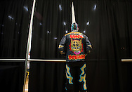 "Lince Dorado (Jose Cordero) looks through the curtains towards the ring before his match during Championship Wrestling Entertainment's ""Wrestlefest"" at the Port St. Lucie Civic Center on Friday, April 10, 2015. CWE is a local ""indie"" wrestling company headquartered in Port St. Lucie. (XAVIER MASCAREÑAS/TREASURE COAST NEWSPAPERS)"