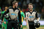 Black Cap's Martin Guptill (L) and Black Cap's Kane Williamson (R) leave the field after their unbeaten opening partnership in the second T20 match of the ANZ International T20 series - New Zealand Black Caps v Pakistan played at Seddon Park, Hamilton, New Zealand on Sunday 17 January 2016. Copyright Photo:  Bruce Lim / www.photosport.nz