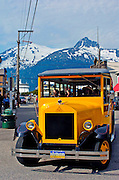 Alaska, Skagway.Visitors ride Skagway Street  car buses to explore streets filled with colorful and historic store fronts in the goldrush town.