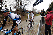 Belgium, March 31 2013: BLANCO PROCYCLING's Maarten Tjallingii and AG2R MONDIALE's  Sébastien Minard on the Oude-Kwaremont during the Ronde van Vlaandaren 2013 elite men cycle race. Copyright 2013 Peter Horrell.