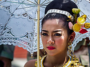 29 OCTOBER 2018 - PHRA PRADAENG, SAMUT PRAKAN, THAILAND: A woman in the parade before the long boat races in Phra Pradaeng. The longboat races go about one kilometer down the Chao Phraya River to the main pier in Phra Pradaeng. The boats are crewed by about 20 oarsmen. Longboat racing traditionally marks the end of the Buddhist Rains Retreat (called Buddhist Lent) in Thai riverside communities.        PHOTO BY JACK KURTZ