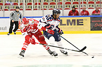 2018-11-14 | Ljungby, Sweden: Troja-Ljungby (22) Carl-Johan Sjögren and Mörrums (21) Malcolm Zander during the game between Troja Ljungby and Mörrums GoIS at Ljungby Arena ( Photo by: Fredrik Sten | Swe Press Photo )<br /> <br /> Keywords: Icehockey, Ljungby, HockeyEttan, Troja Ljungby, Mörrums GoIS, Ljungby Arena div1, division, troja, ljungby, mörrum, gois,