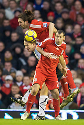 LIVERPOOL, ENGLAND - Saturday, January 30, 2010: Liverpool's Javier Mascherano and Sotirios Kyrgiakos challenge Bolton Wanderers' Kevin Davies during the Premiership match at Anfield. (Photo by: David Rawcliffe/Propaganda)