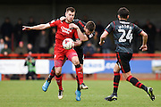 Crawley Town forward James Collins (19) is put under pressure by Doncaster Rovers defender Andrew Butler (6) during the EFL Sky Bet League 2 match between Crawley Town and Doncaster Rovers at the Checkatrade.com Stadium, Crawley, England on 04 March 2017. Photo by David Charbit.