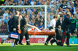 STOKE, ENGLAND - Saturday, September 12, 2009: Stoke City's James Beattie is carried off injured during the Premiership match against Chelsea at the Britannia Stadium. (Pic by Gareth Davies/Propaganda)