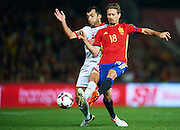 GRANADA, SPAIN - NOVEMBER 12:  Goran Pandev of FYR Macedonia (L) competes for the ball with Nacho Monreal of Spain (R) during the FIFA 2018 World Cup Qualifier between Spain and FYR Macedonia at  on November 12, 2016 in Granada, .  (Photo by Aitor Alcalde Colomer/Getty Images)