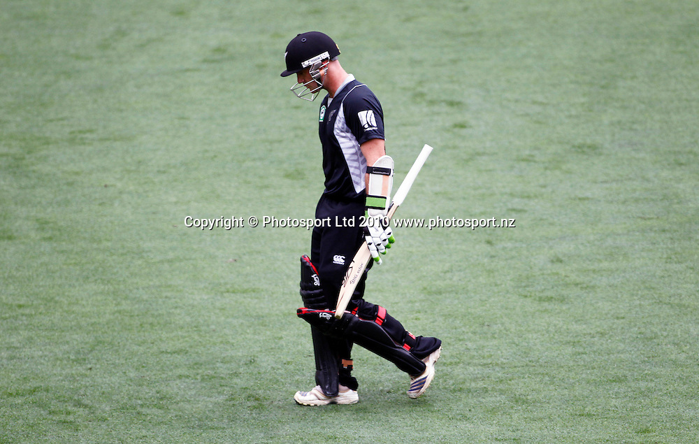 Blackcaps batsman Gareth Hopkins walks dejectedly back to the pavillion after being dismissed. 4th one day international. New Zealand Black Caps versus Australia one day Chappell Hadlee cricket series. Eden Park, Auckland, New Zealand. Thursday 11 March 2010. Photo: Simon Watts/PHOTOSPORT