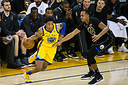 Golden State Warriors guard Patrick McCaw (0) dribbles the ball against the Milwaukee Bucks at Oracle Arena in Oakland, Calif., on March 29, 2018. (Stan Olszewski/Special to S.F. Examiner)