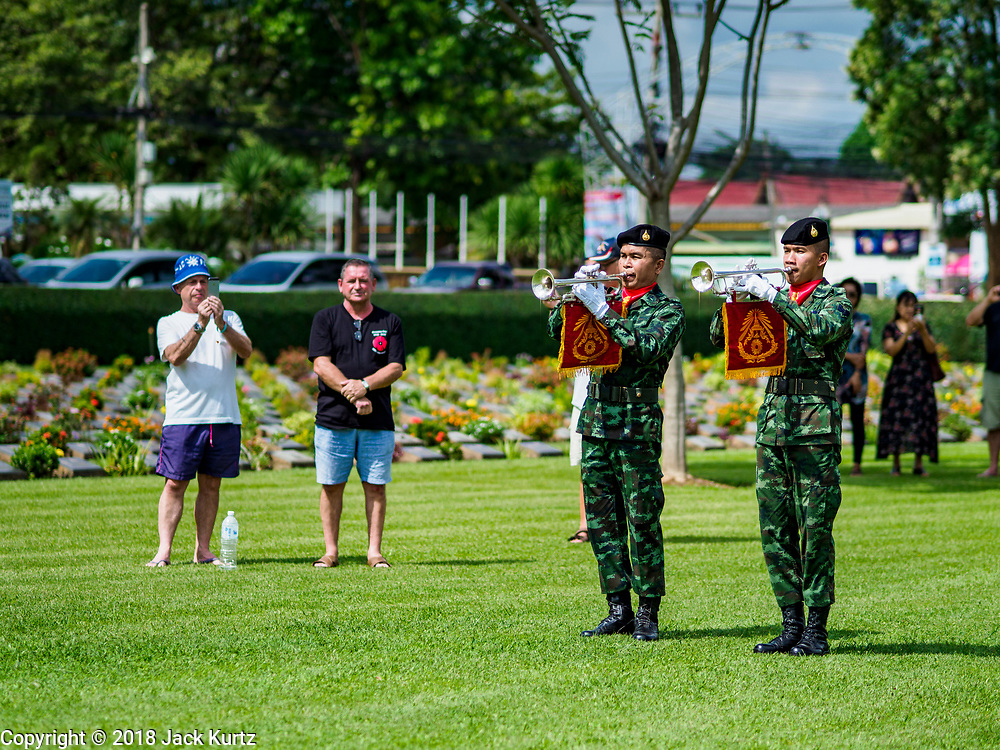 "11 NOVEMBER 2018 - KANCHANABURI, KANCHANABURI, THAILAND:  Thai buglers play during the Rememberance Day ceremony at the Kanchanaburi War Cemetery in Kanchanaburi, Thailand. Kanchanaburi is the location of the infamous ""Bridge On the River Kwai"" and was known for the ""Death Railway"" built by Japan during World War II using allied, principally British, Australian and Dutch prisoners of war as slave labor. There are 6,982 people buried in the cemetery, 5,000 Commonwealth soldiers and 1,800 Dutch soldiers. November 11, 2018 marked the 100th anniversary of the end of World War I, celebrated Rememberance Day in the UK and the Commonwealth and Veterans' Day in the US.     PHOTO BY JACK KURTZ"