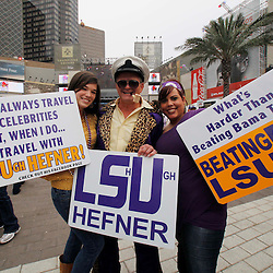 Jan 9, 2012; New Orleans, LA, USA; LSU Tigers fan known as LSU Hefner (middle) poses for a photo with Annie Kilburn (left) and Megan Louque (right) before the 2012 BCS National Championship game against the Alabama Crimson Tide at the Mercedes-Benz Superdome.  Mandatory Credit: Derick E. Hingle-US PRESSWIRE