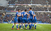 Brighton player Jamie Murphy is mobbed after opening the scoring during the Sky Bet Championship match between Brighton and Hove Albion and Milton Keynes Dons at the American Express Community Stadium, Brighton and Hove, England on 7 November 2015. Photo by Bennett Dean.