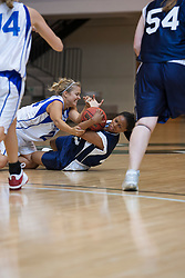 21 June 2008: Mandy Kirby (24) lands on Zhaque Gray (43) during a scramble to gather up a loose ball. IBCA ( Illinois Coaches Basketball Association) Girls Class 3 & 4 All Star Game held at the Shirk Center on the Campus of Illinois Wesleyan University in Bloomington Illinois