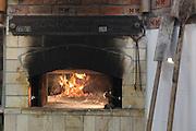Lit stone oven