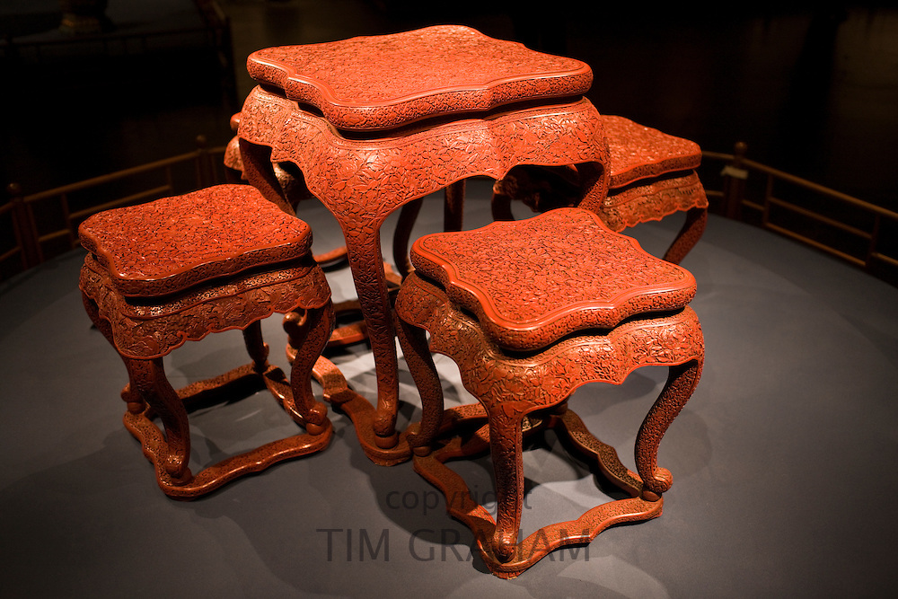 Red lacquer square table and stools with carved floral design on display in the Shanghai Museum, China