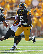 August 31 2013: Iowa Hawkeyes running back Damon Bullock (5) on a run during the first quarter of the NCAA football game between the Northern Illinois Huskies and the Iowa Hawkeyes at Kinnick Stadium in Iowa City, Iowa on August 31, 2013. Northern Illinois defeated Iowa 30-27.