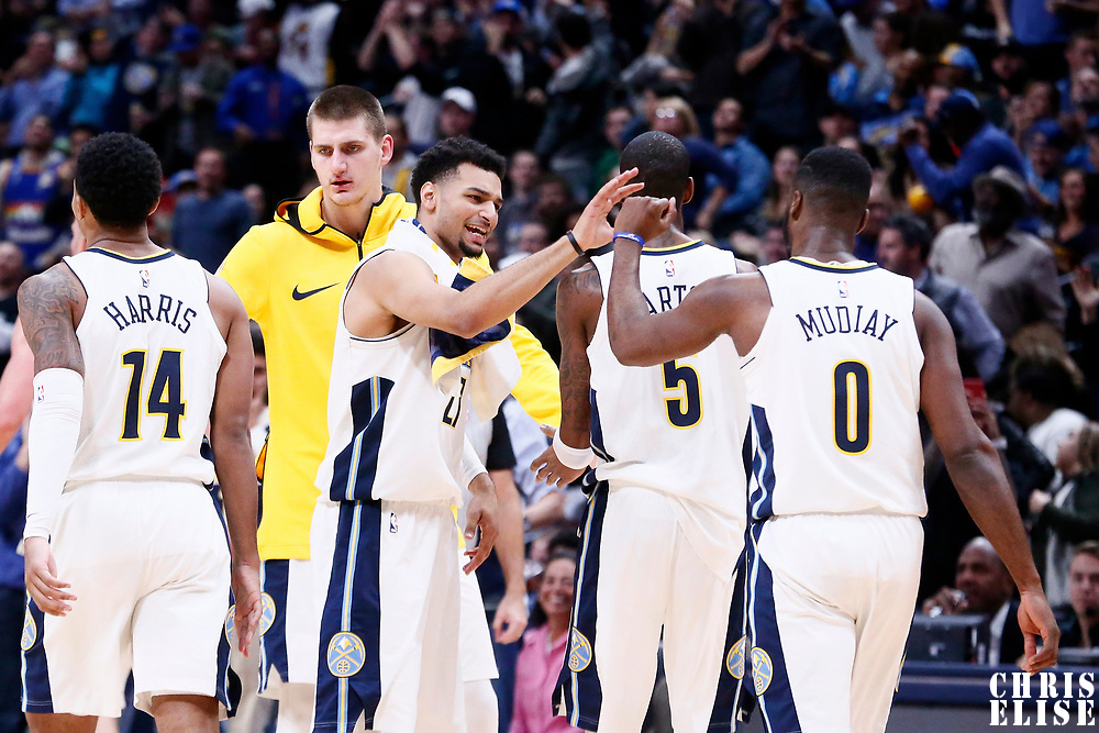 09 November 2017: Denver Nuggets guard Emmanuel Mudiay (0) is congratulated by Denver Nuggets guard Jamal Murray (27) next to Denver Nuggets guard Will Barton (5), Denver Nuggets guard Gary Harris (14) and Denver Nuggets center Nikola Jokic (15) during the Denver Nuggets 102-94 victory over the Oklahoma City Thunder, at the Pepsi Center, Denver, Colorado, USA.
