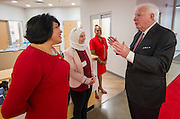Former governor Mark White talks with school staff and volunteers before a dedication ceremony at Mark White Elementary School, December 13, 2016.