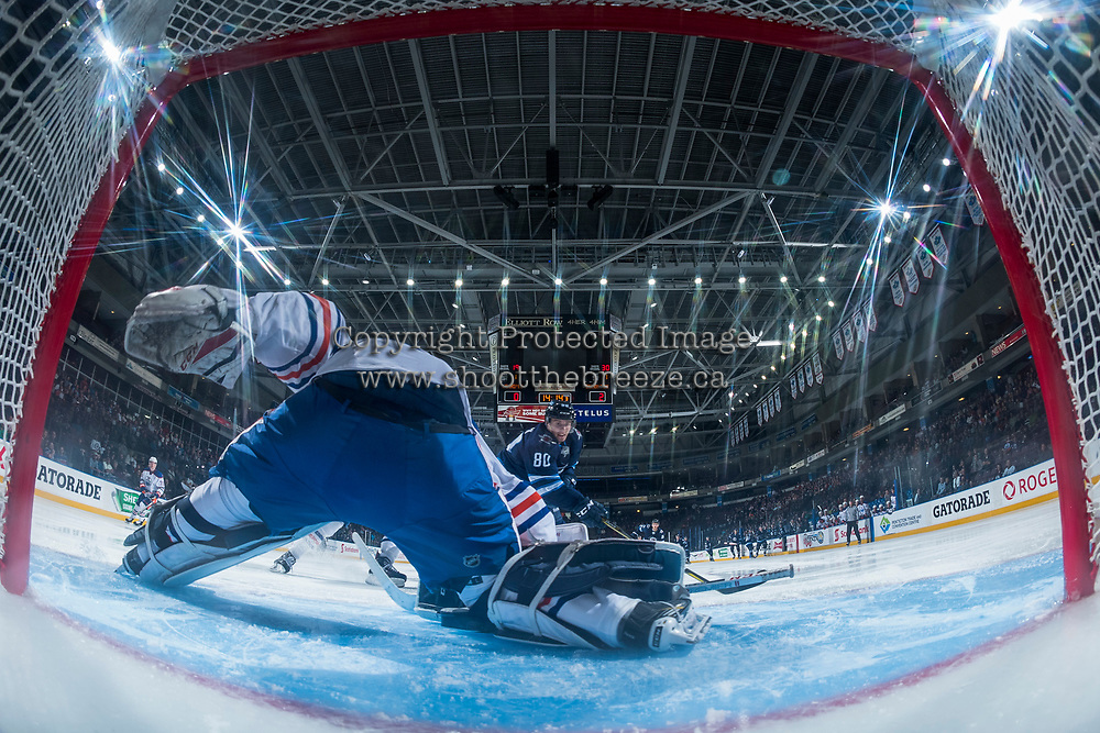 PENTICTON, CANADA - SEPTEMBER 9: Michael Spacek #80 of Winnipeg Jets looks for a shot against Stuart Skinner #50 of Edmonton Oilerson September 9, 2017 at the South Okanagan Event Centre in Penticton, British Columbia, Canada.  (Photo by Marissa Baecker/Shoot the Breeze)  *** Local Caption ***