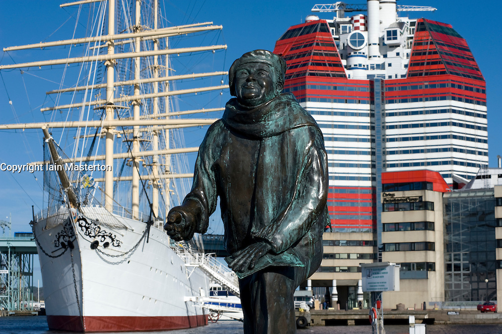Sculpture of singer Evert Taube and Striking Utkiken Tower  also known as the Lipstick Tower and the Viking sailing ship in Lilla Bommen Harbour in Gothenburg Sweden