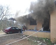Oxford firemen at a house fire at 507 Molly Barr Cove on Monday, February 1, 2010 in Oxford, Miss.