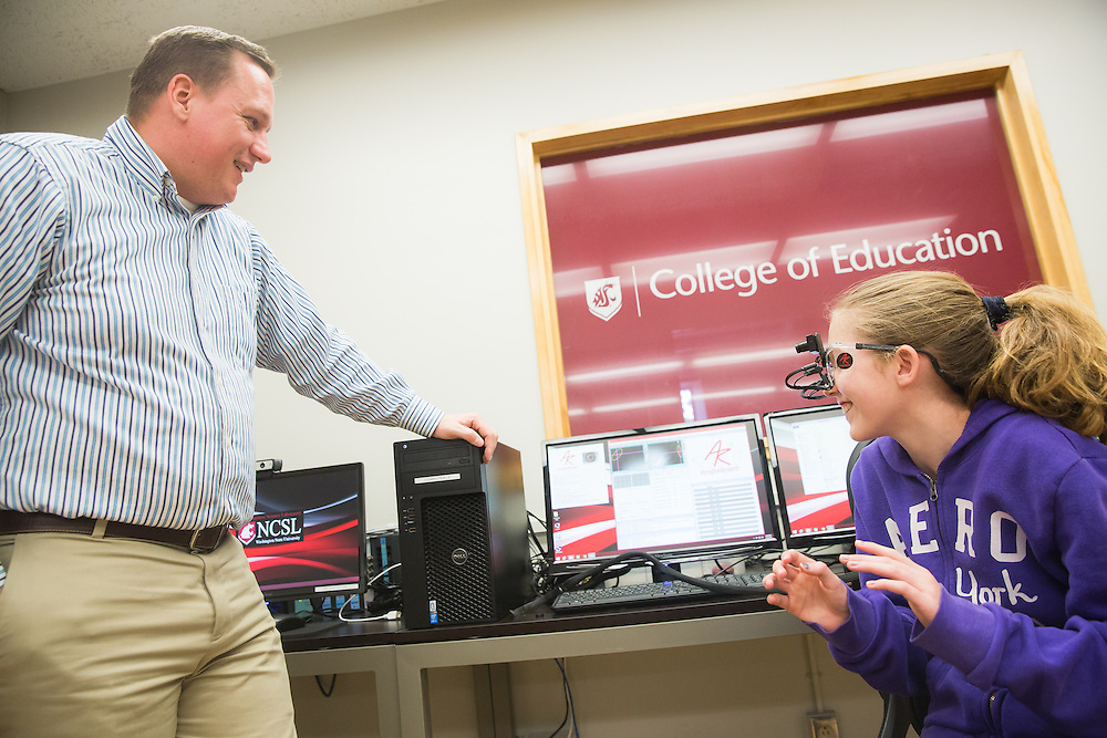 Dr. Richard Lamb, associate professor of science education measurement at Washington State University,  shows  Alexis Grow, 12, a sixth-grade student at Sunnyside Elementary in Pullman, Wash., the software that works with  a pair of eye-tracking glasses on during a field trip to the Washington State University neurocognition sciene lab Monday, Feb. 22, 2016.