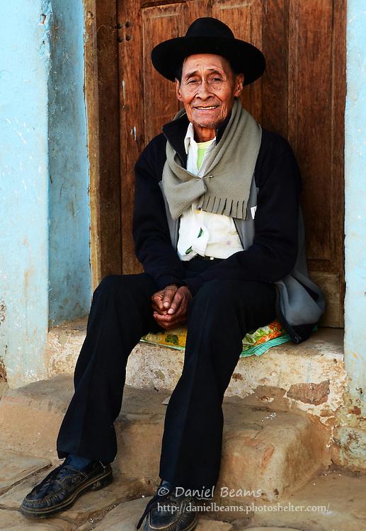 Elderly man on sitting on door step in Samaipata, Santa Cruz, Bolivia