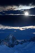 Mount Tinzenhorn with a super blue moon at late dusk, Savognin, Parc Ela, Grisons, Switzerland