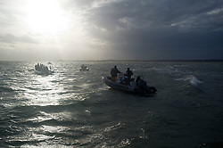 © London News Pictures. 17/09/2012. Southampton, UK. Boats setting off towards the sandbank.  Teams play a cricket match on the Bramble Bank in the middle of The Solent on September 17, 2012.  The annual cricket match between the Royal Southern Yacht Club and The Island Sailing Club, takes place on a sandbank which appears for 30 minutes at lowest tide. The game lasts until the tide returns. Photo credit : Ben Cawthra/LNP.