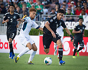 Mexico striker Raul Jiménez (9) dribbles past Cuba midfielder Luismel Morris (20) during a game between Mexico and Cuba in a CONCACAF Gold Cup soccer match in Pasadena, Calif., Saturday, June 15, 2019. Mexico defeated Cuba 7-0. (Ed Ruvalcaba/Image of Sport)