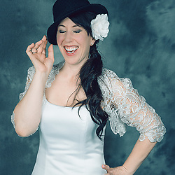"The bride enjoying our ""open air"" photo booth. This is included in all of our wedding packages. Your guest can have free formals and lots of fun!! Everyone gets involved."