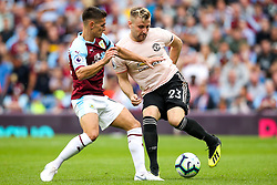Luke Shaw of Manchester United takes on Ashley Westwood of Burnley - Mandatory by-line: Robbie Stephenson/JMP - 02/09/2018 - FOOTBALL - Turf Moor - Burnley, England - Burnley v Manchester United - Premier League
